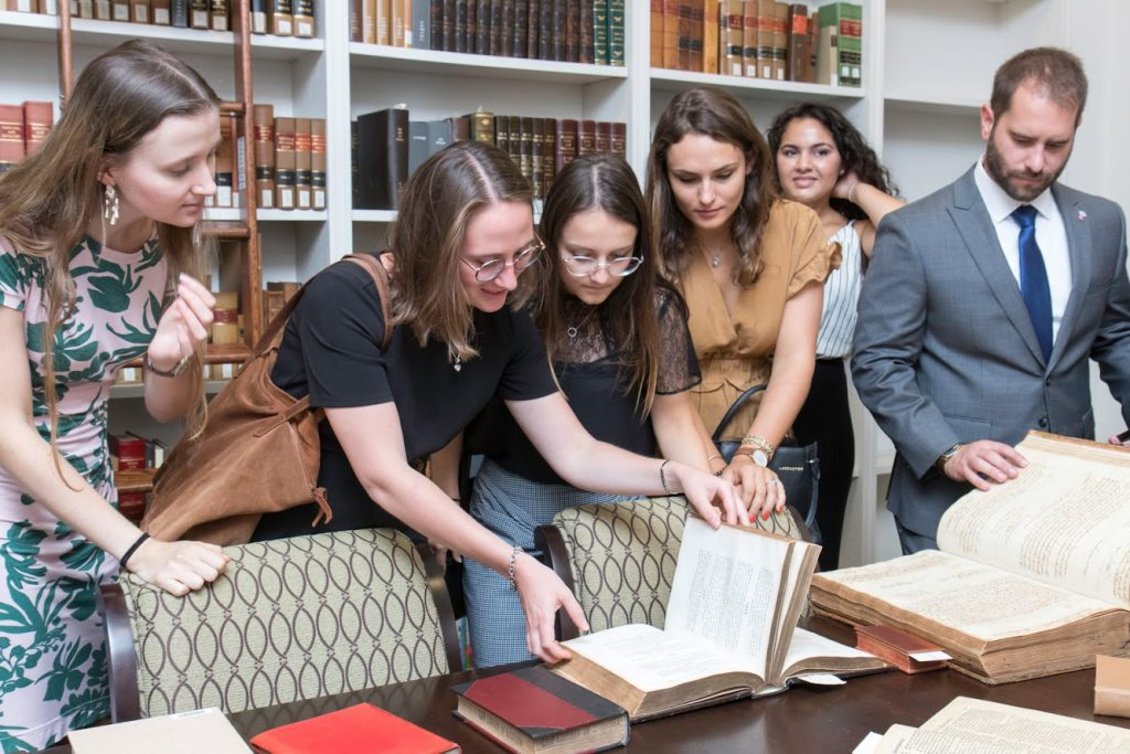 Students looking at old law books in the rare book room