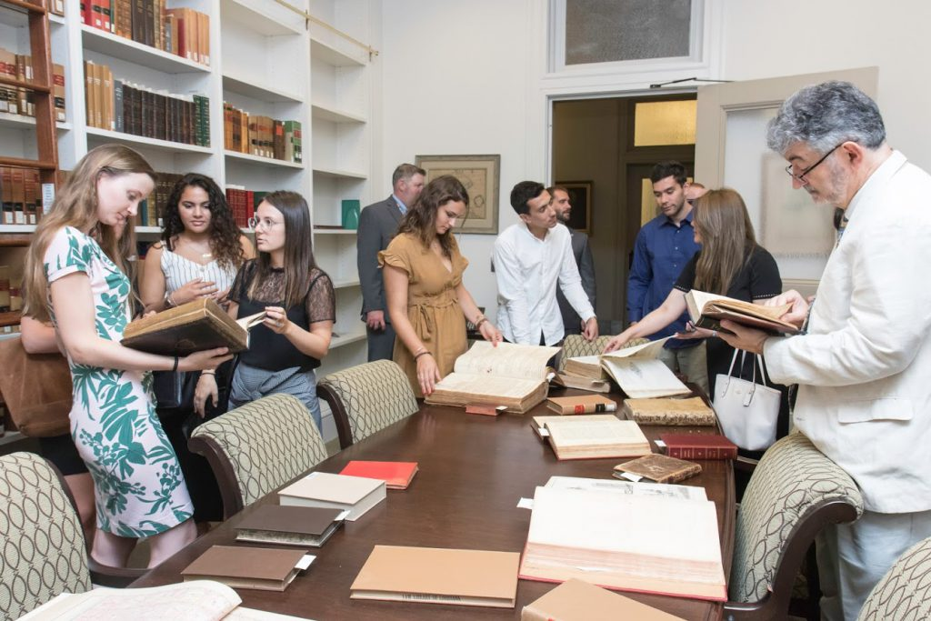 The group perusing old law books in the rare book room