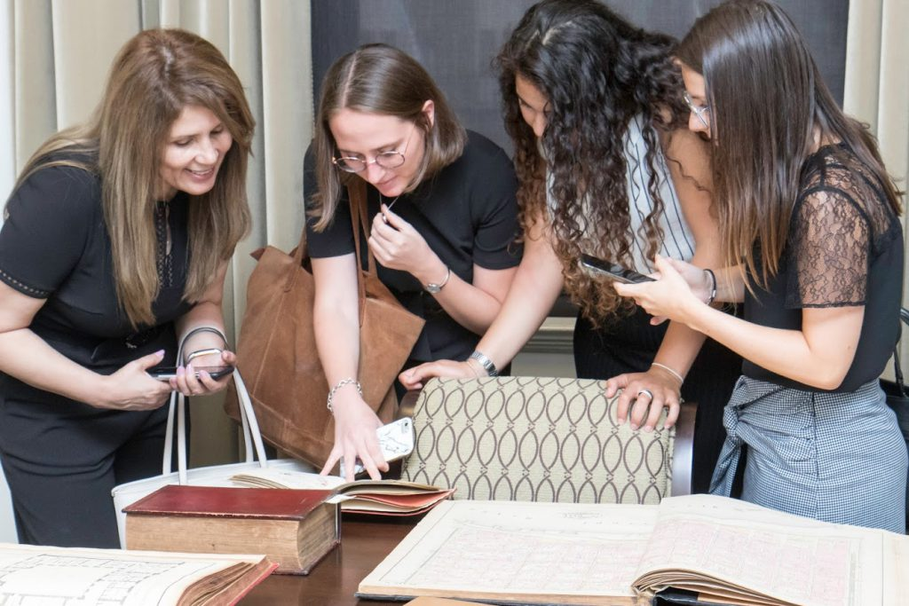 LLM students marveling at a rare book