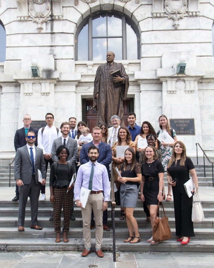 The LLM Group with JD students and Prof. O. Moreteau in front of Chief Justice E.D. White statue and the Louisiana Supreme Court building in the background.
