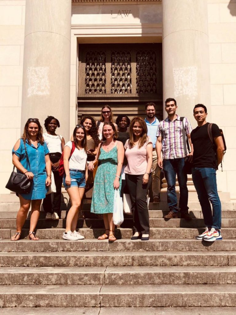 A photo of the 11 candidates of the 2020 LL.M. Class on the steps of the Law School, Old Building