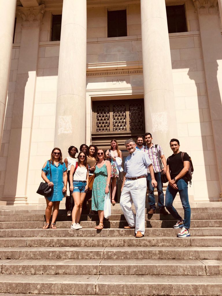 A photo of 10 candidates of the 2020 LL.M. Class posing with Prof. Olivier Moreteau on the steps of the Law School, Old Building